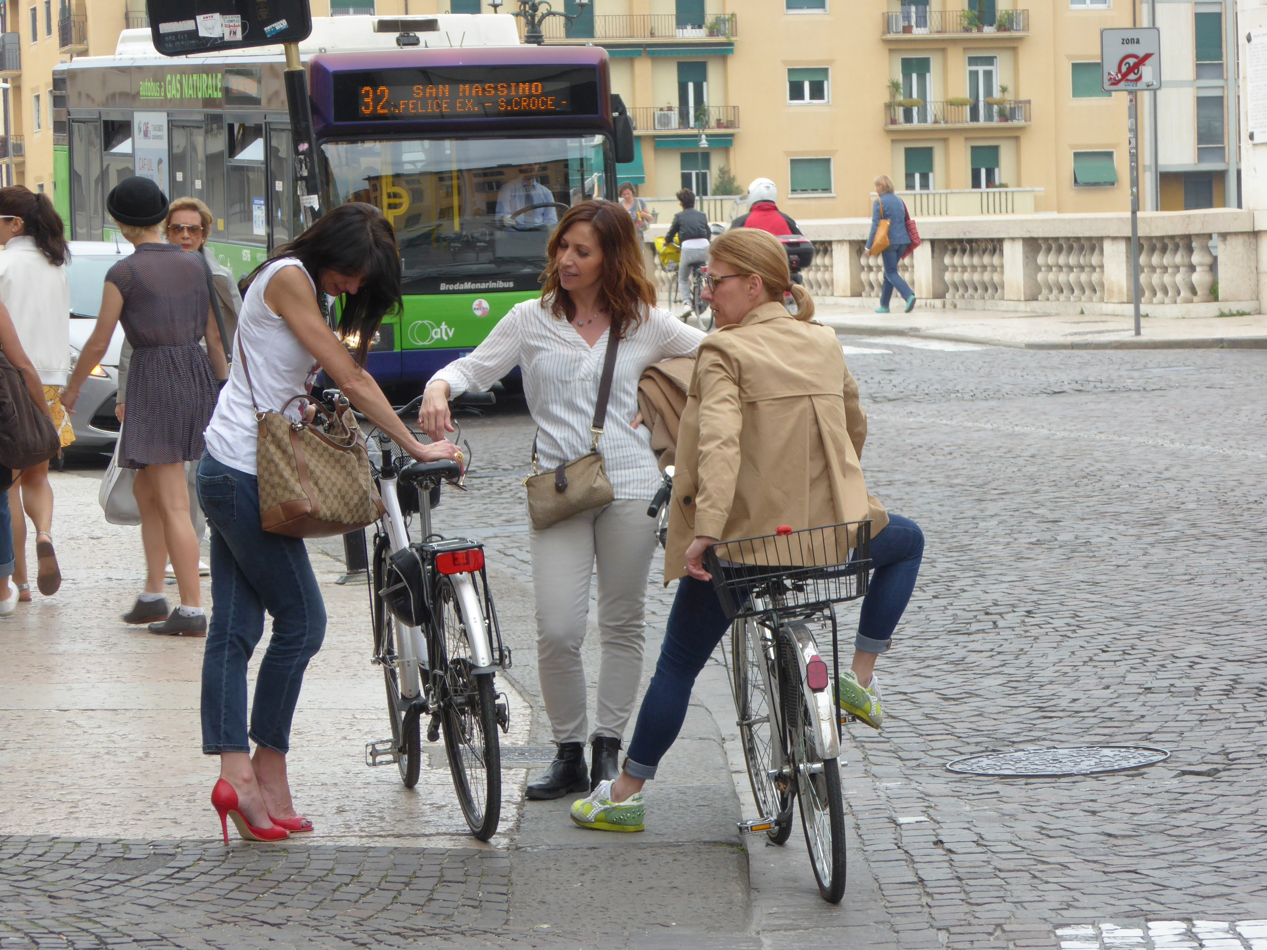 italian women in red bikes and buses a very short 474